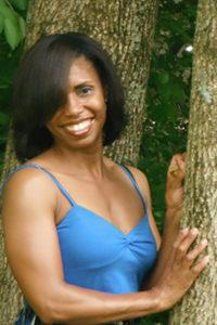 Sakinah Bellamy by tree upper pose.